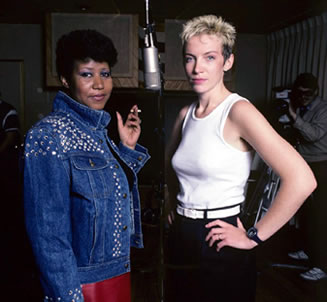 Annie Lennox and Aretha Franklin - behind every great man there's a great woman